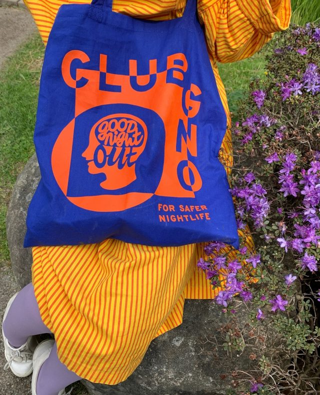 A Club GNO tote bag out in the wild! 😍  Club GNO is a new way to join our movement for safer nightlife, wherever you are in the world. For £5 or more a month, members receive free access to specialist skills workshops, online toolkits and exclusive merch.   Over the past seven years we've trained thousands of nightlife workers and accredited hundreds of premises and organisers. Your membership helps us support more workplaces and communities to respond to and prevent sexual violence 💙🧡.⠀ ⠀  https://www.goodnightoutcampaign.org/clubgno/    #GoodNightOutCampaign #ConsentCulture #EndingHarassment #Grassroots #Feminism #Women #London #Music #TimesUp #Venue #Consent #Training #ClubGNO